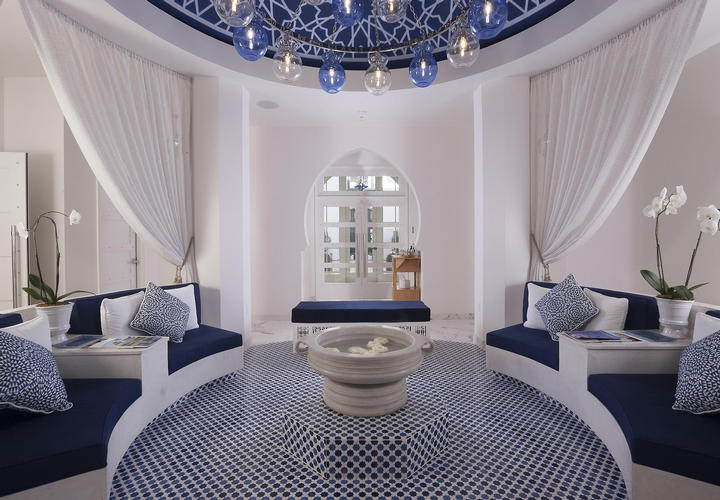 blue and white colored spa room with couches