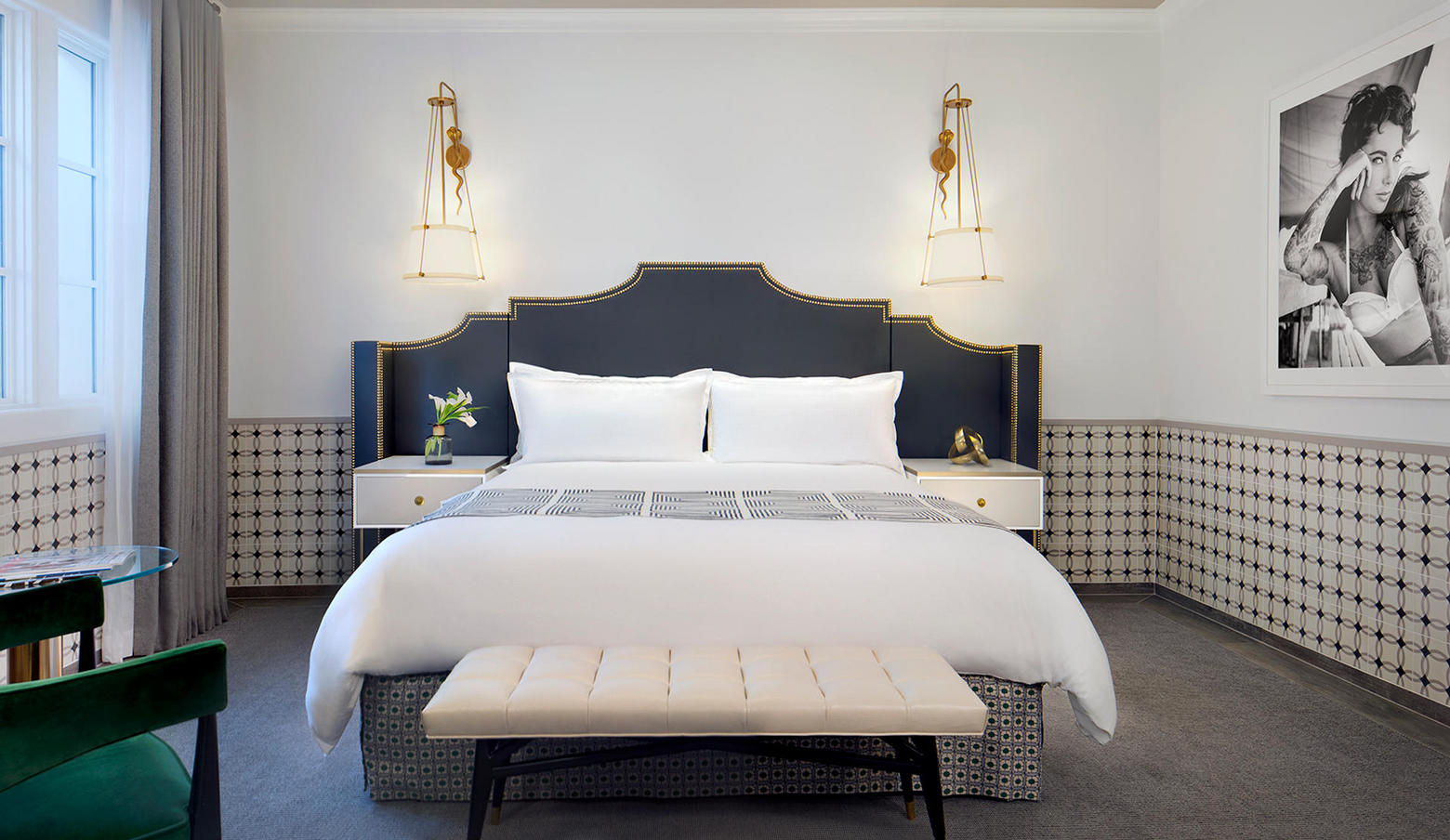 luxury king guest room with white and navy bed